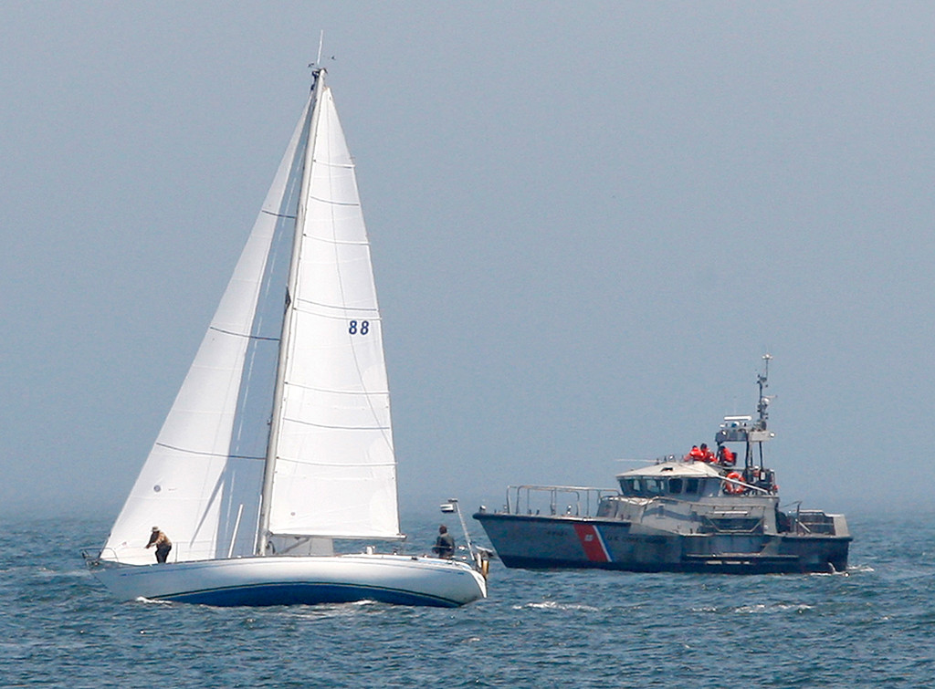 . A sailboat and the Coast Guard 47-foot motor lifeboat head out of the Monterey Harbor on Monday, August 6, 2018.  (Vern Fisher - Monterey Herald)
