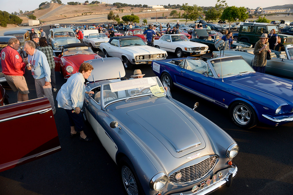. Classic cars enter the raceway to Laguna Seca on Thursday, August 9, 2018 to participate in the California\'s Dream Drive celebrating the re-opening of Highway 1.  Dozens of classic cars and modern day vehicles drove from Monterey County to San Luis Obispo County.  (Vern Fisher - Monterey Herald)
