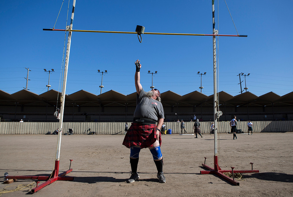 . John Harland, 54, of Newman, Calif. tosses a 42lb. weight over during the masters division of the Weight Over a Bar competition at the Monterey Scottish Games & Celtic Festival at the Monterey Fairgrounds and Event Center on Saturday August 4, 2018. Contestants in the Heavy Athletics competed in nine different events. (David Royal/ Herald Correspondent)