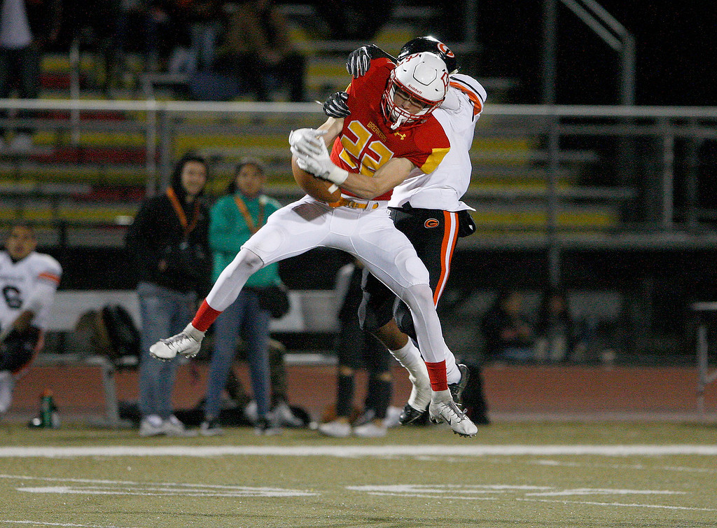 . Pacific Grove High School\'s Parker McAnally (22) breaks up a pass intended to Gonzales High School\'s Franky Cisneros (8) runs for yards during their game in Pacific Grove on Friday, August 31, 2018.  (Vern Fisher - Monterey Herald)