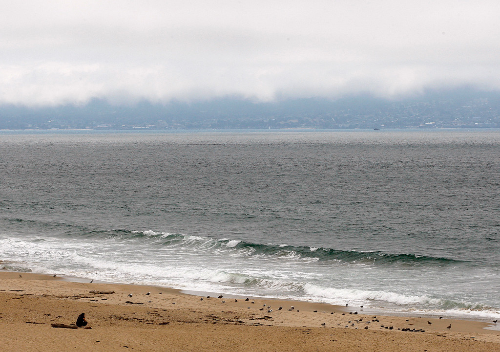 . Looking south from Marina State Beach as a persistent fog layer covers Monterey on Tuesday, September 4, 2018.  (Vern Fisher - Monterey Herald)