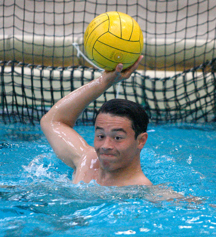 . Jeremy Isack at practice with the Monterey High School boys varsity water polo team on Wednesday, September 5, 2018.  The water polo teams at Monterey High practice at their pool which dates back to the 1930s and is not regulation size which forces teams to play all away matches.  (Vern Fisher - Monterey Herald)