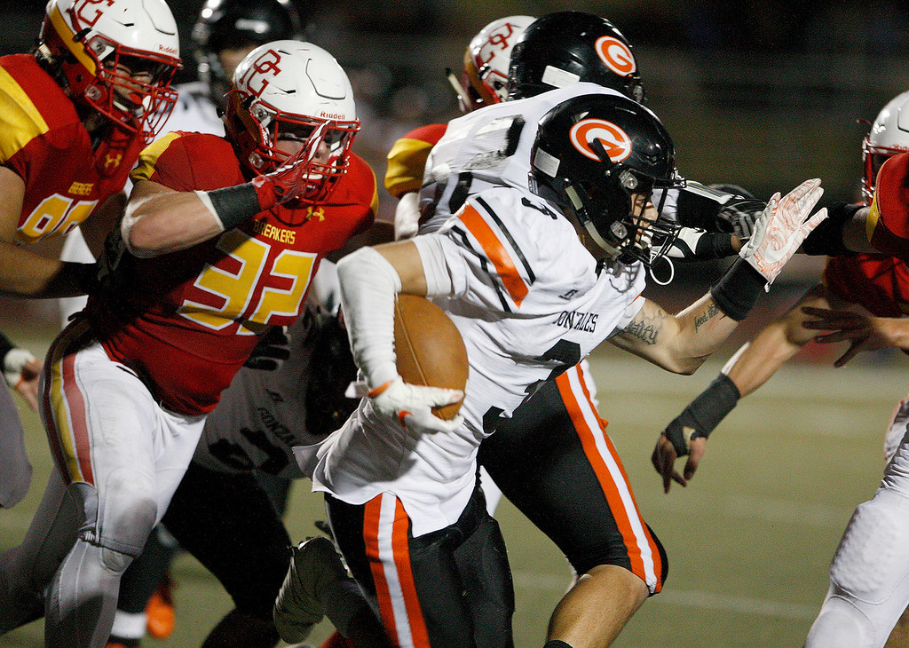 . Gonzales High School\'s Gilbert Payton Flores (3) runs for yards during their game against Pacific Grove High School on Friday, August 31, 2018.  (Vern Fisher - Monterey Herald)