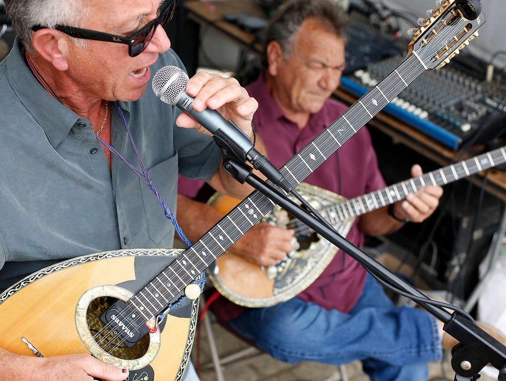 . Brothers Kanello Chronopoulos, left, and his brother Yanni Chronopoulos both from Greece play Bouzouki and sing with the Spartan Band during the Greek Festival at Custom House Plaza in Monterey on Saturday September 1, 2018. (David Royal/ Herald Correspondent)