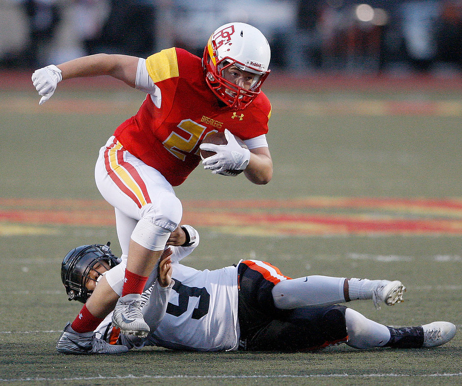 . Pacific Grove High School\'s Anthony DaSilva (24) avoids Gonzales High School defenders MIchael Rosas (9) during their game in Pacific Grove on Friday, August 31, 2018.  (Vern Fisher - Monterey Herald)