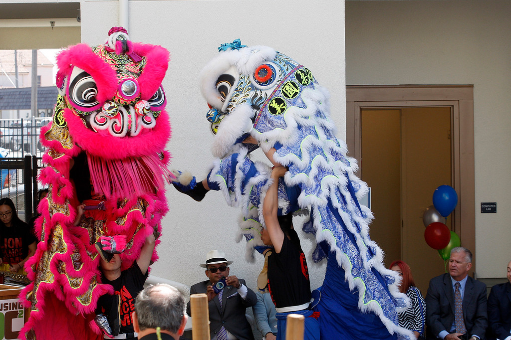 . A dragon dance was part of the ceremony as the Monterey County Housing Authority Development Corporation (HDC) celebrated their grand opening of their most recent affordable housing redevelopment in Salinas on Thursday, September 6, 2018.    The Hikari phase on East Rossi Street will consist of fifty units in the one, two and three bedroom size.  (Vern Fisher - Monterey Herald)