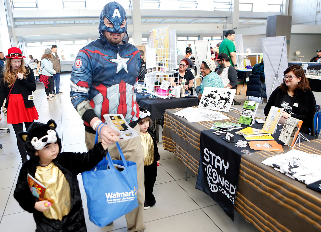 . Matt Swartzel is dressed as a retired Captan America with son Sebastian and daughter Aaralyn dressed as cats during the Salinas Valley Comic Con at Hartnell College in Salinas on Monday December 17, 2017. (David Royal/Herald Correspondent)