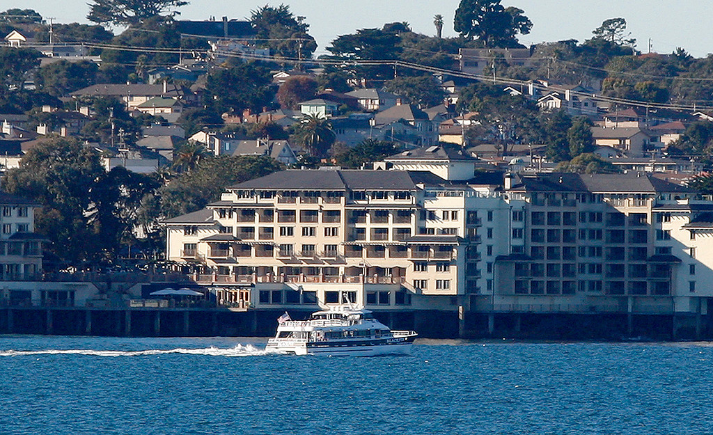 . A whale watching boat heads out from the Monterey Harbor in Monterey on Thursday, Dec. 21, 2017.  (Vern Fisher - Monterey Herald)