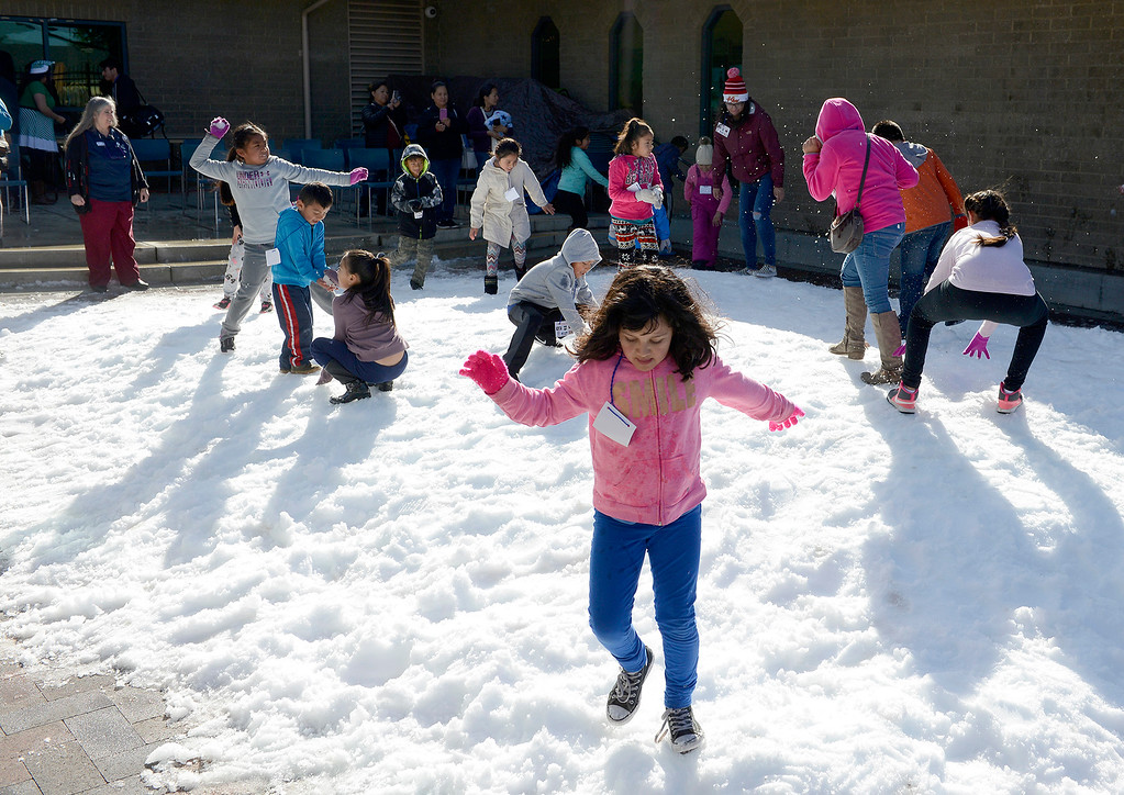 . Children play in the snow at Cesar Chavez Library in Salinas on Wednesday, Dec. 20, 2017.  (Vern Fisher - Monterey Herald)