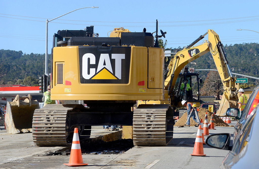 . Heavy equipment working on Fremont Street in Monterey on Wednesday, Dec. 20, 2017 on the water delivery pipeline.  (Vern Fisher - Monterey Herald)