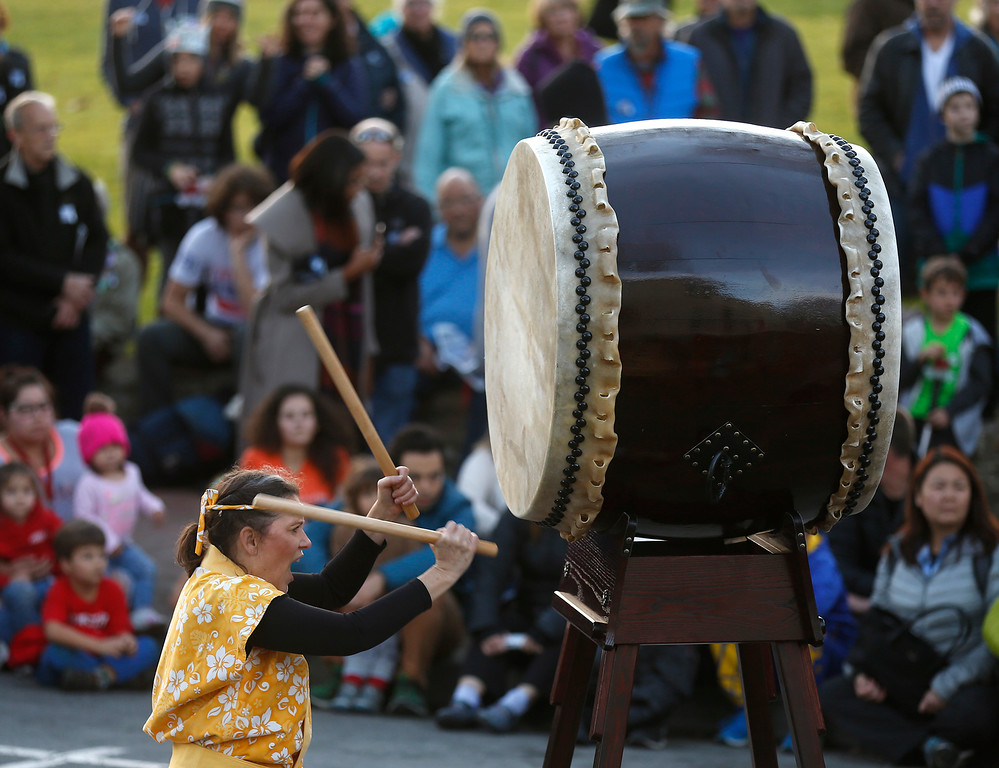 . Pam Dally-La Mica plays the daiko drum with Shinsho Mugen Daiko during the First Night New Year Eve celebrations at Colton Hall in Monterey on Sunday December 31, 2017. (David Royal/Herald Correspondent)