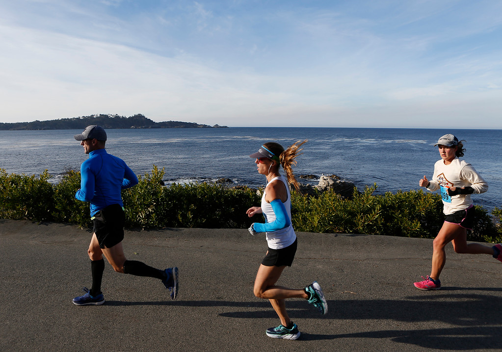 . Runners pass Point Lobos in the distance as they make their way along Scenic Road during the Rio Grille Resolution Run in Carmel on Monday January 1, 2018. (David Royal/Herald Correspondent)