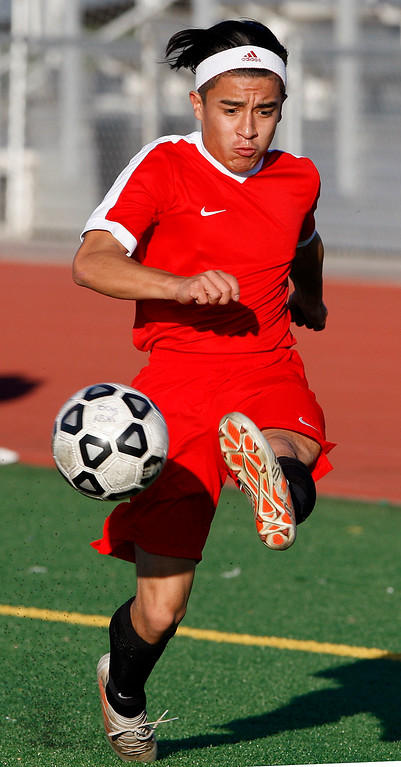 . Seaside High\'s Juan Gopar (5) dribbles the ball during their match against North Salinas High in Salinas on Thursday, Jan. 4, 2018.  (Vern Fisher - Monterey Herald)