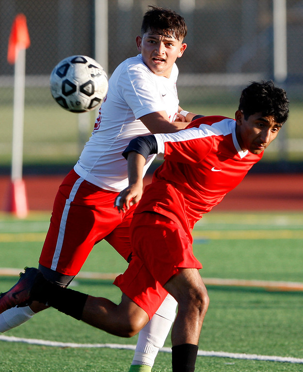 . North Salinas High\'s Oscar Regalado (16) battles Seaside High\'s Robert Sierra (14) during their match against North Salinas High in Salinas on Thursday, Jan. 4, 2018.  (Vern Fisher - Monterey Herald)