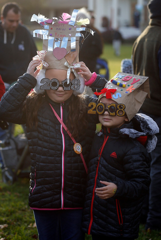 . Carly O\'Neal, 8, and her brother Caden, 5, of Semi Valley make last minute adjustments after building party hats during the First Night New Year Eve celebrations at Colton Hall in Monterey on Sunday December 31, 2017. (David Royal/Herald Correspondent)