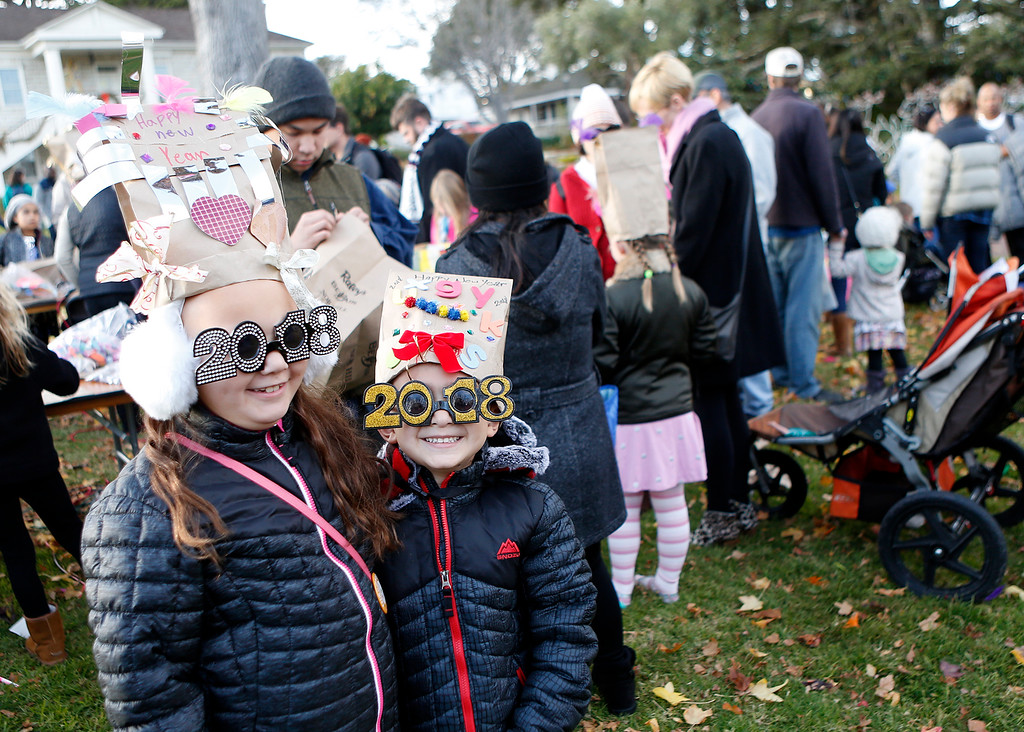 . Carly O\'Neal, 8, and her brother Caden, 5, of Semi Valley don shades after completing party hats during the First Night New Year Eve celebrations at Colton Hall in Monterey on Sunday December 31, 2017. (David Royal/Herald Correspondent)