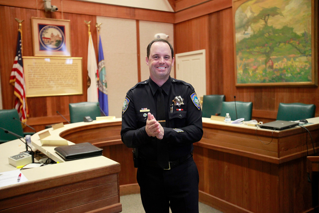 . Informal pinning of Carmel\'s new police chief Paul Tomasi in the city council chambers on Friday, Dec. 30, 2016.   (Vern Fisher - Monterey Herald)