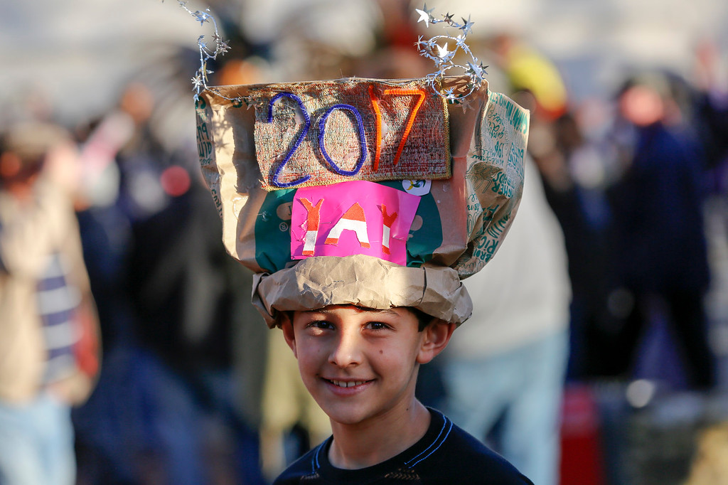 . Micah Ezekiel, 9, of San Jose looks on as he wears his self-made celebration hat durning First Night Monterey 2017 on Saturday, December 31, 2016 in Monterey, Calif. (Vernon McKnight/Herald Correspondent)