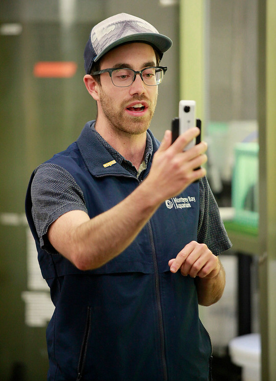 . Patrick Webster, the Monterey Bay Aquarium\'s social media producer, was live on Wednesday, Jan. 4, 2017 on camera with a special 360-degree attachment on his smartphone that creates the 360-degree experience for viewers on Periscope.  (Vern Fisher - Monterey Herald)