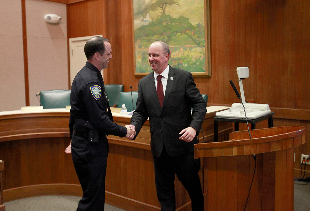 . Informal pinning of Carmel\'s new police chief Paul Tomasi by Chip Rerig, city administrator, City of Carmel-by-the-Sea on Friday, Dec. 30, 2016.   (Vern Fisher - Monterey Herald)