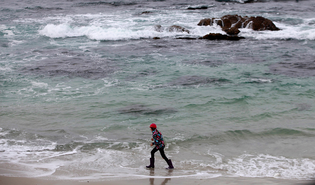 . A young girls plays in the surf at Asilomar State Beach in Pacific Grove on Tuesday, Jan. 3, 2017.  (Vern Fisher - Monterey Herald)