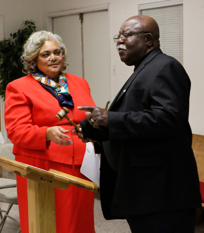 . Out-going Monterey County NAACP president Joe Watson passes the gavel to in-coming president Regina Mason during the Monterey County branch of the NAACP swearing-in ceremony at Friendship Baptist Church on Monday, January 2, 2017 in Seaside, Calif. (Vernon McKnight/Herald Correspondent)