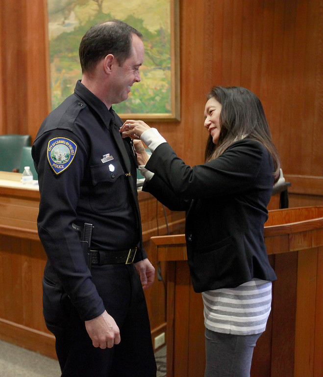 . Informal pinning of Carmel\'s new police chief Paul Tomasi by his wife Tracy Tomasi on Friday, Dec. 30, 2016.   (Vern Fisher - Monterey Herald)