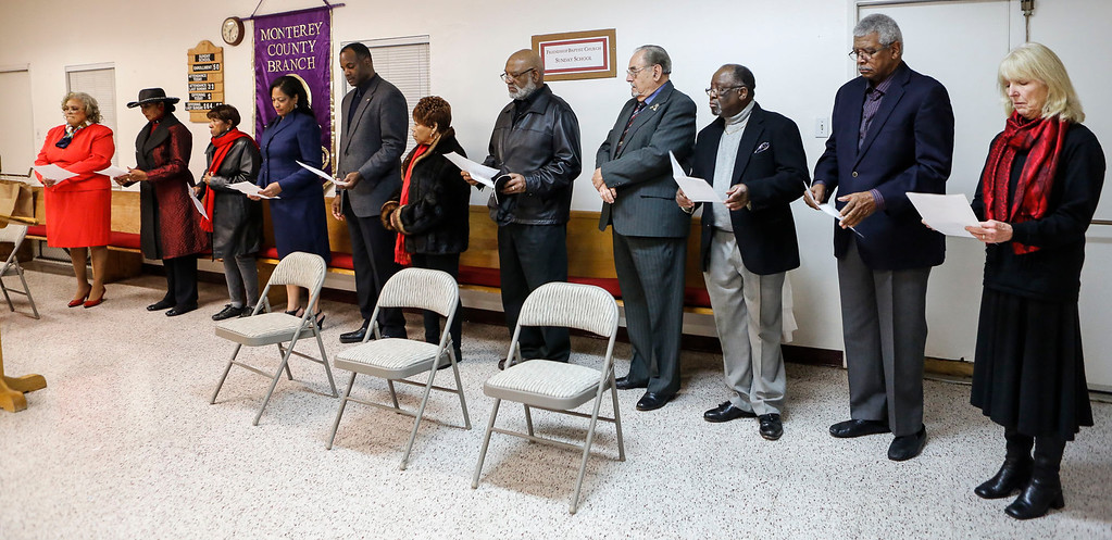 . In-coming Monterey County NAACP president Regina Mason, far left, stands with the executive committee during the Monterey County branch of the NAACP swearing-in ceremony at Friendship Baptist Church on Monday, January 2, 2017 in Seaside, Calif. (Vernon McKnight/Herald Correspondent)