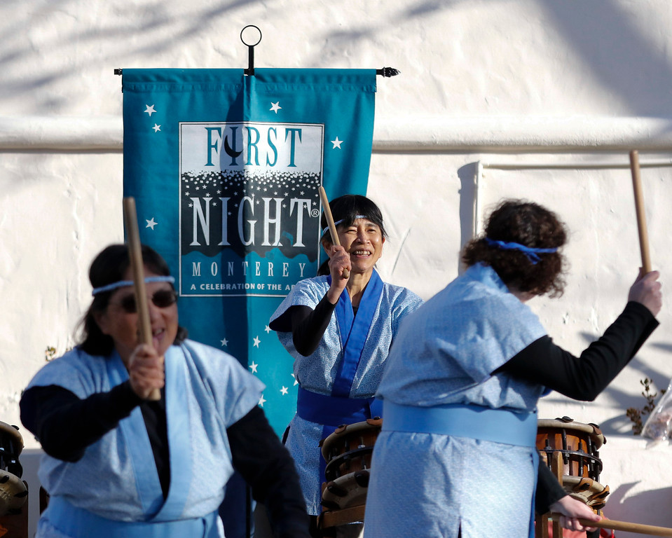 . Shinsho Mugen Daiko performs on Pacific St. in front of Colton Hall durning the opening ceremony of First Night Monterey 2017 on Saturday, December 31, 2016 in Monterey, Calif. (Vernon McKnight/Herald Correspondent)