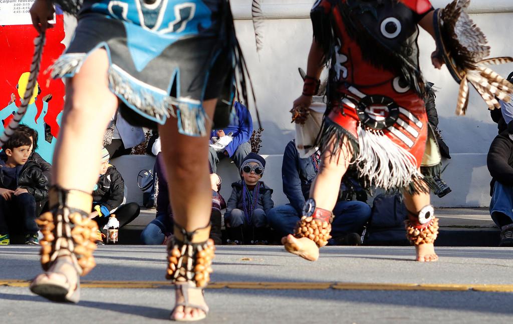 . Jordan Styker, 4, of Santa Cruz watches Calpulli Yaocuauhtli performs a traditional Aztec dance during the opening ceremony of First Night Monterey 2017 on Saturday, December 31, 2016 in Monterey, Calif. (Vernon McKnight/Herald Correspondent)