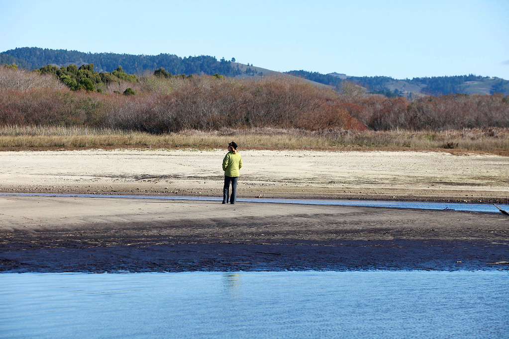 . A woman views the empty Carmel River estuary at Carmel River State Beach on Thursday, Jan. 5, 2016.  (Vern Fisher - Monterey Herald)