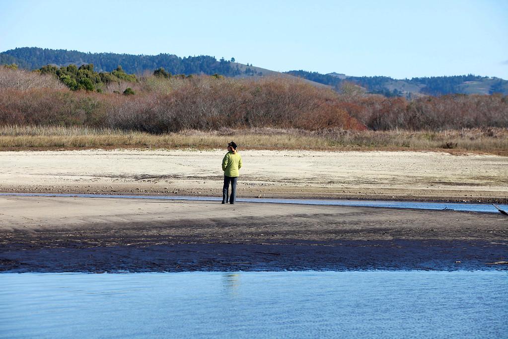 . A woman views the empty Carmel River estuary at Carmel River State Beach on Thursday, Jan. 5, 2016.  (Vern Fisher - Monterey Herald)
