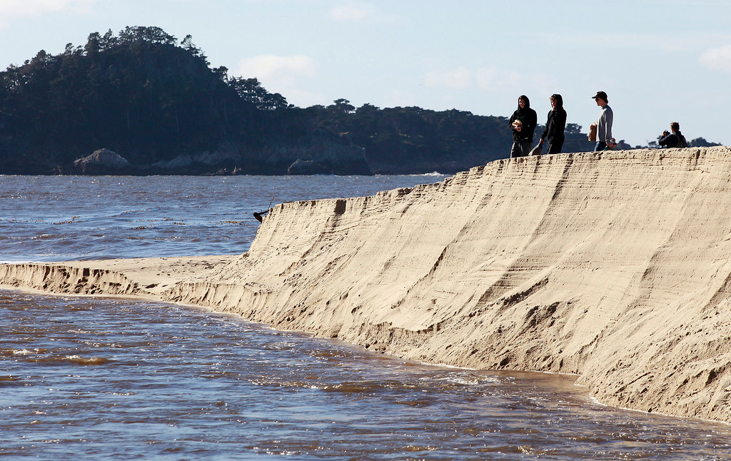 . The Carmel River has broken through the sand bar and is flowing to the bay at Carmel River State Beach on Thursday, Jan. 5, 2017.  (Vern Fisher - Monterey Herald)