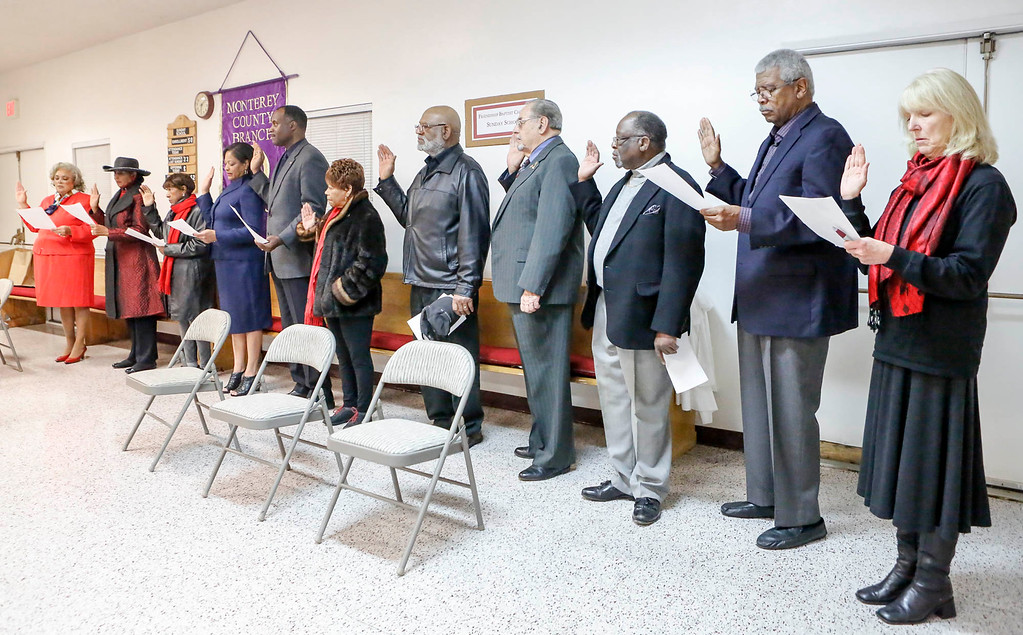 . In-coming Monterey County NAACP president Regina Mason, far left, and the executive committee are sworn in during the Monterey County branch of the NAACP swearing-in ceremony at Friendship Baptist Church on Monday, January 2, 2017 in Seaside, Calif. (Vernon McKnight/Herald Correspondent)
