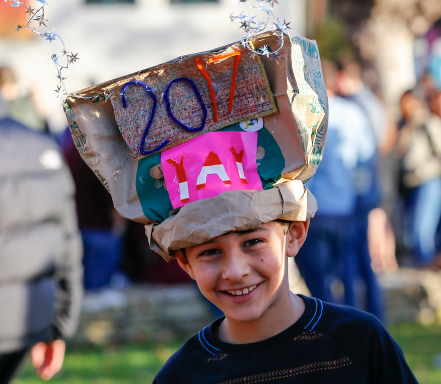 . Micah Ezekiel, 9, of San Jose looks on as he wears his self-made celebration hat durning First Night Monterey 2017 on Saturday, December 31, 2016 in Monterey, Calif. (Vernon McKnight/Herald Correspondent)