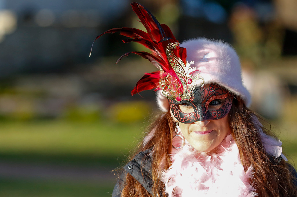 . Aria Colby of Monterey, wearing a festive mask, smiles as she looks on at her family enjoying activities (not seen) durning First Night Monterey on Saturday, December 31, 2016 in Monterey, Calif. (Vernon McKnight/Herald Correspondent)