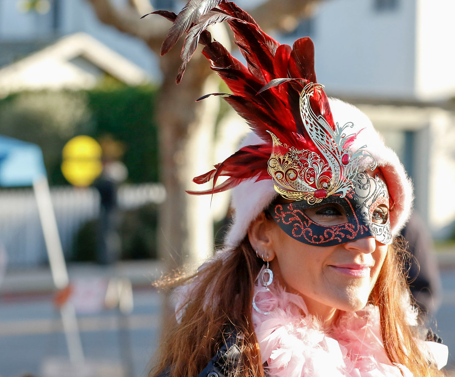 . Aria Colby of Monterey, wearing a festive mask, looks on durning First Night Monterey 2017 on Saturday, December 31, 2016 in Monterey, Calif. (Vernon McKnight/Herald Correspondent)