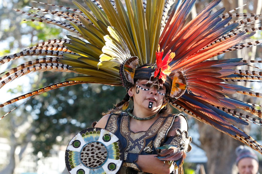 . A member of Calpulli Yaocuauhtli performs a traditional Aztec dance on Pacific St. in front of Colton Hallduring the opening ceremony of First Night Monterey 2017 on Saturday, December 31, 2016 in Monterey, Calif. (Vernon McKnight/Herald Correspondent)