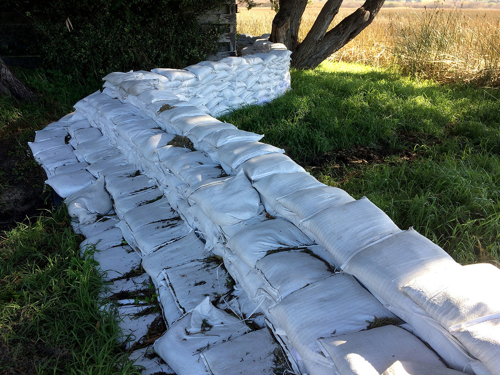 . Sandbags in place on Camino Real in Carmel on Thursday, Jan. 5, 2016.  (Vern Fisher - Monterey Herald)