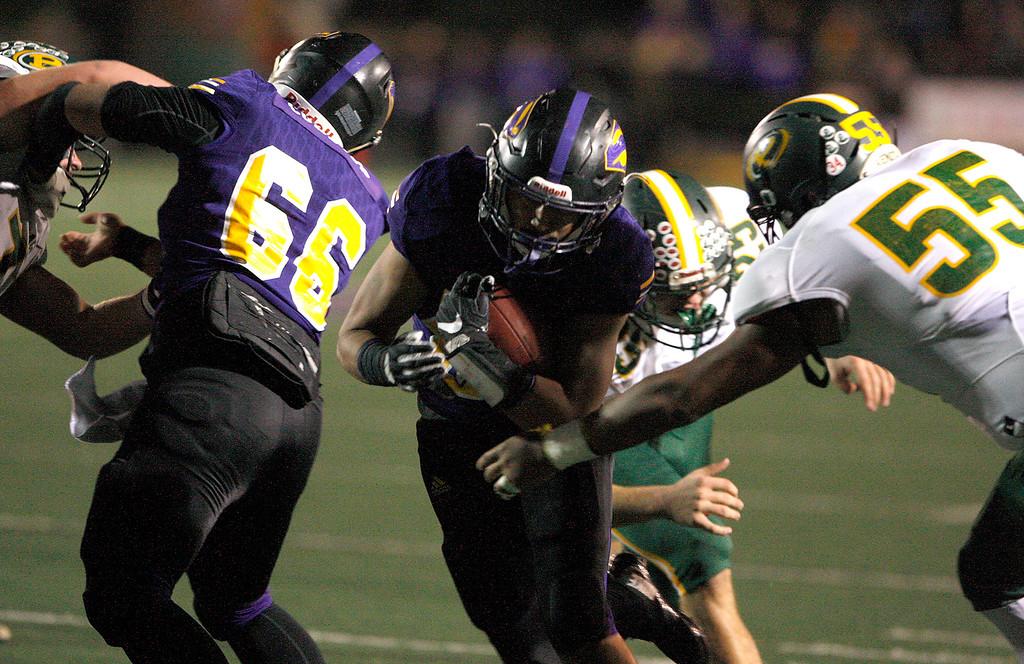 . Salinas High running back Richard Cerda (24) runs for yards in the first half of their Division 4-AA CIF State Football Championship Bowl Game against Placer High School on Friday, Dec. 8, 2017 in Salinas.  Placer High beat Salinas High in overtime 43-42 to advance to the CIF State Final.  (Vern Fisher - Monterey Herald)