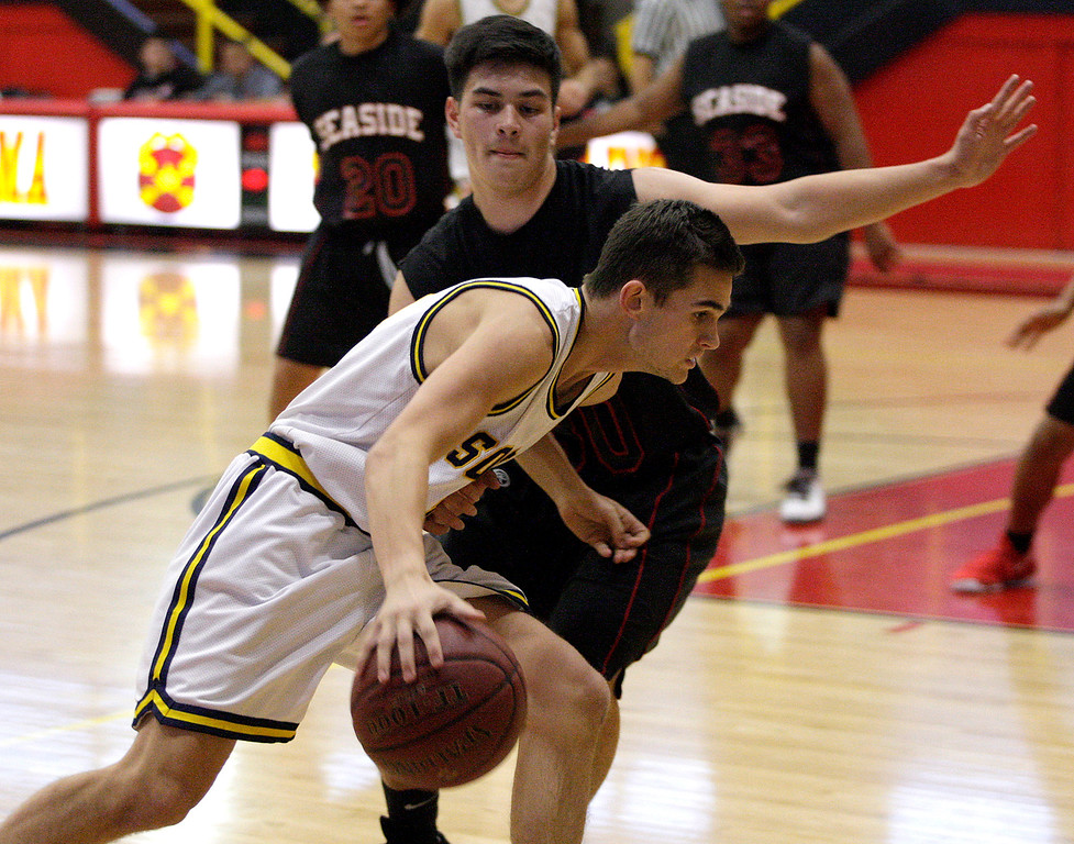. Soquel High\'s Ryan Murtha (13) drives against Seaside High\'s Jordan Banon (30) during their game in the Luis Scattini Memorial Tournament at Palma School in Salinas on Thursday, Dec. 14, 2017.  (Vern Fisher - Monterey Herald)