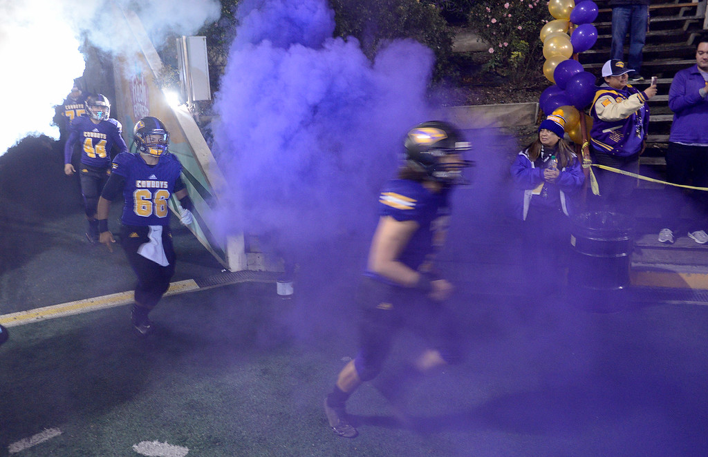 . Salinas High players take the field prior to their Division 4-AA CIF State Football Championship Bowl Game against Placer High on Friday, Dec. 8, 2017 in Salinas.  Placer High beat Salinas High in overtime 43-42 to advance to the CIF State Final.  (Vern Fisher - Monterey Herald)