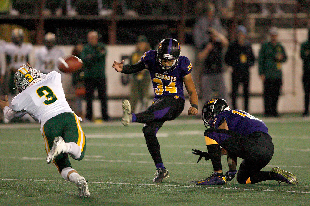 . Salinas High kicker Adrian Hernandez (34) with a successful extra point in the first half of their Division 4-AA CIF State Football Championship Bowl Game against Placer High School on Friday, Dec. 8, 2017 in Salinas.  Placer High beat Salinas High in overtime 43-42 to advance to the CIF State Final.   (Vern Fisher - Monterey Herald)