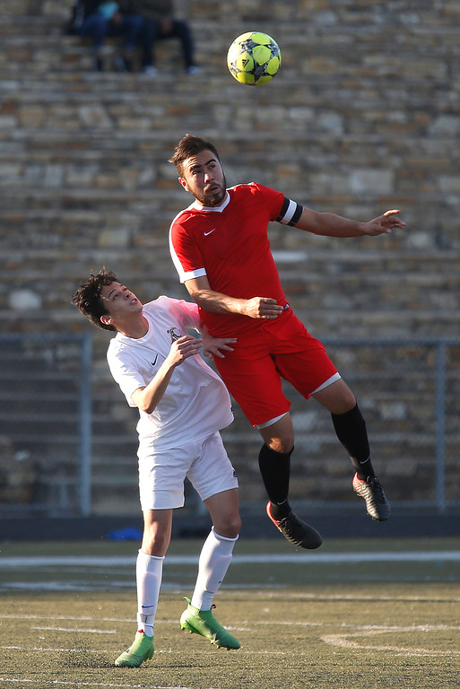 . Seaside\'s Bryan Hernandez goes up for a header above Monterey\'s Kale McGillis during boys soccer at Monterey High School on Wednesday December 13, 2017. (David Royal/Herald Correspondent)