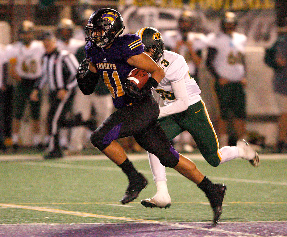 . Salinas High running back Mike Cortez (41) rushes for yards in the second half during the Division 4-AA CIF State Football Championship Bowl Game against Placer High School on Friday, Dec. 8, 2017 in Salinas.  Placer High beat Salinas High in overtime 43-42 to advance to the CIF State Final.  (Vern Fisher - Monterey Herald)