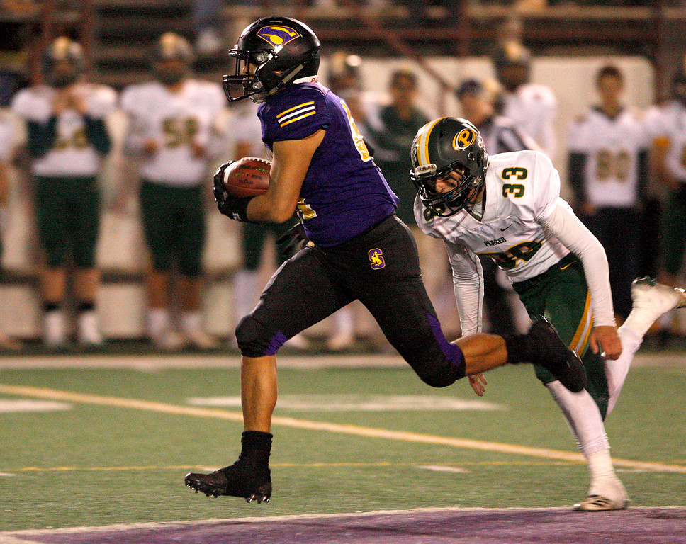 . Salinas High running back Mike Cortez (41) rushes past Placer High\'s Colin Wright (33) in the second half during the Division 4-AA CIF State Football Championship Bowl Game on Friday, Dec. 8, 2017 in Salinas.  Placer High beat Salinas High in overtime 43-42 to advance to the CIF State Final.  (Vern Fisher - Monterey Herald)