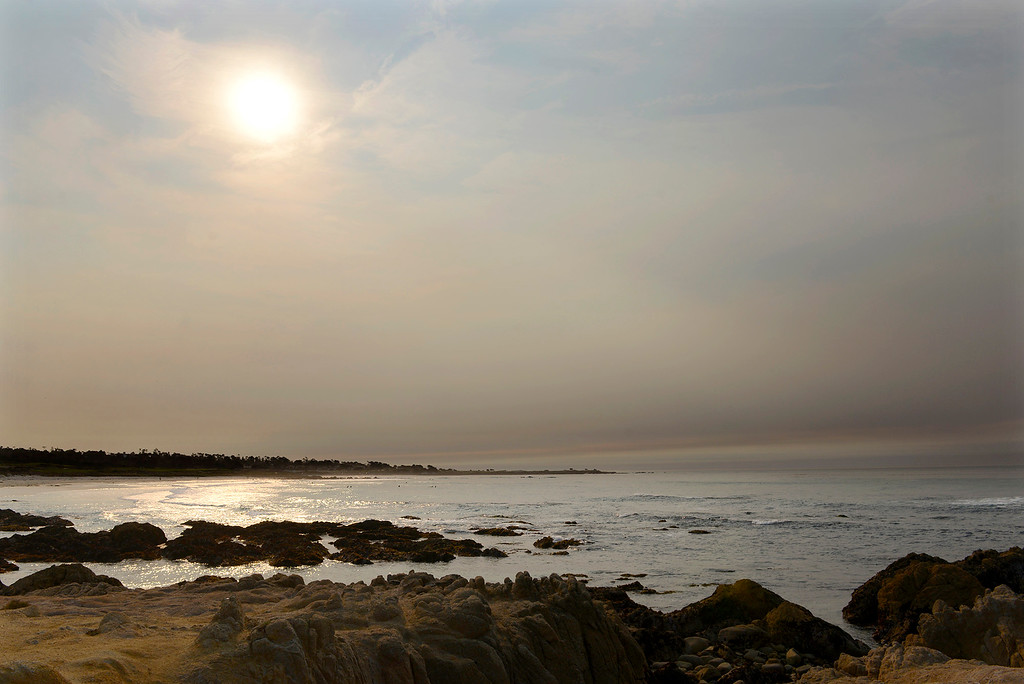 . Drift smoke from fires burning in southern California hangs over Asilomar State Beach in Pacific Grove on Monday, Dec. 11, 2017.  (Vern Fisher - Monterey Herald)