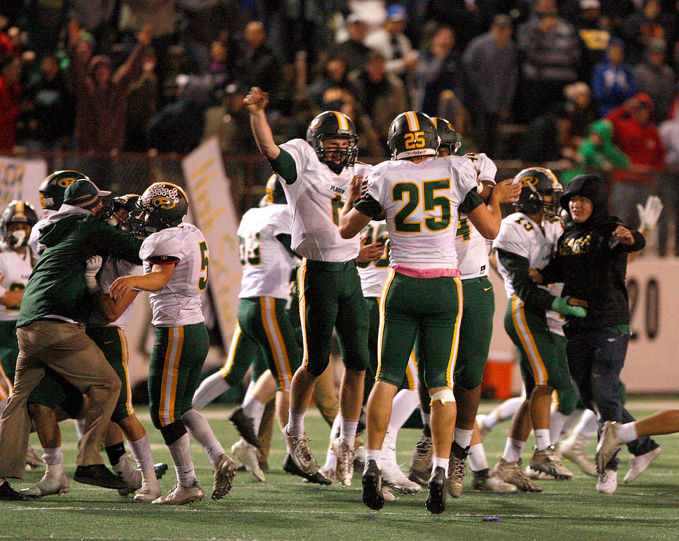 . Placer High celebrates their overtime victory over Salinas High, 43-42 in their Division 4-AA CIF State Football Championship Bowl Game on Friday, Dec. 8, 2017 in Salinas.  Placer High will advance to the CIF State Final.  (Vern Fisher - Monterey Herald)