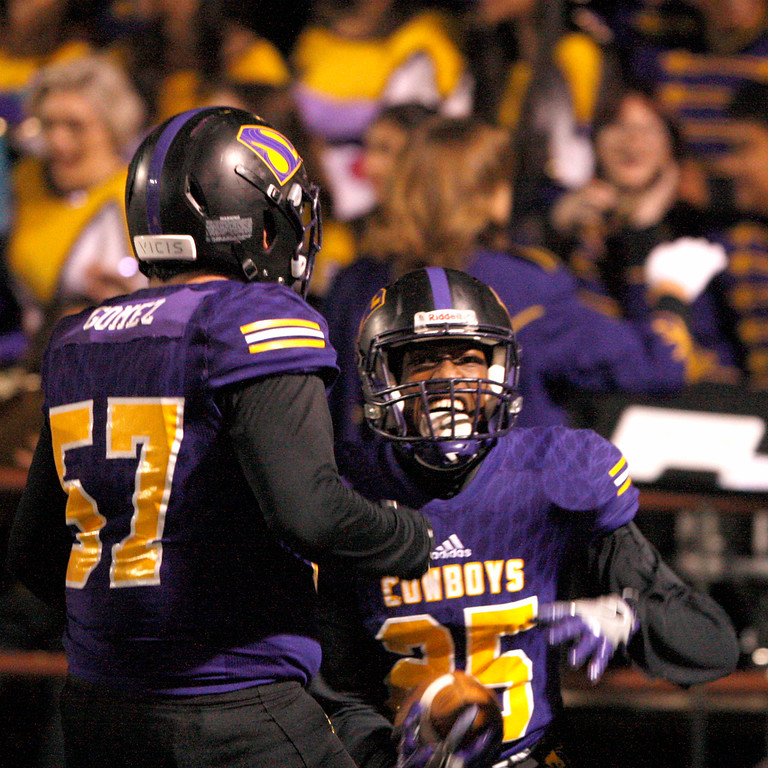 . Salinas High\'s Andre Calder (25) celebrates with teammate Sebastian Gomez (57) after returing an interception for a touchdown in the first half of their Division 4-AA CIF State Football Championship Bowl Game against Placer High School on Friday, Dec. 8, 2017 in Salinas.  (Vern Fisher - Monterey Herald)