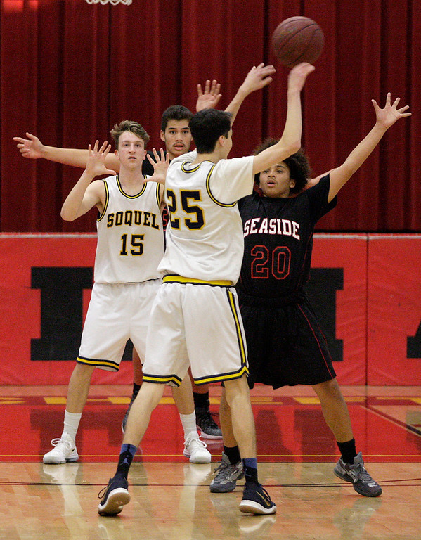 . Soquel High\'s Lincoln Cooley (15) Andrew Schumacher (25) and Seaside High\'s Justin Waters (20) during their game in the Luis Scattini Memorial Tournament at Palma School in Salinas on Thursday, Dec. 14, 2017.  (Vern Fisher - Monterey Herald)